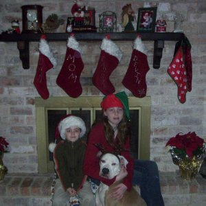 All 3 of my babies X-mas 2008, Kaly's the one with the raindeer antlers.